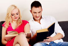 Young couple reading a books together Stock Image