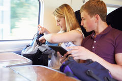 Young Couple Reading E Book On Train Journey Royalty Free Stock Photography