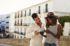 Young couple reading a guidebook, waist up, Ibiza, Spain Royalty Free Stock Photos