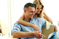 Young couple reading magazine Stock Images