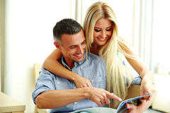 Young couple reading magazine Stock Photography