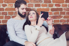 Young couple reading tablet and share opinion. With each other or online shopping royalty free stock photo