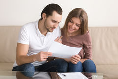 Young couple reading terms and conditions before signing contrac royalty free stock photos