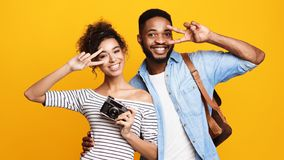 Young Couple Ready For Trip, Orange Background royalty free stock photo