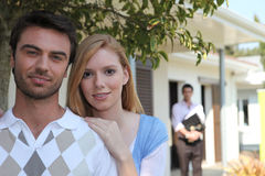 Young couple with realtor Stock Photo
