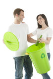 Young couple recycling Royalty Free Stock Image