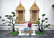 Couple of tourist in the Wat Pho royalty free stock image