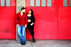 Young Couple Red Doors Royalty Free Stock Image
