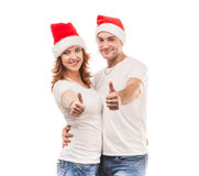 Young couple in red hats with thumbs up Royalty Free Stock Image