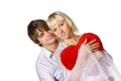 Young couple with red heart Stock Photos