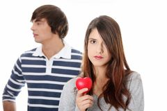 Young couple with red heart. Royalty Free Stock Photography