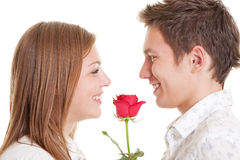 Young couple with red rose Royalty Free Stock Photography