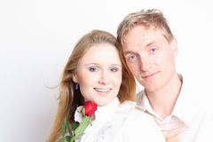 Young couple with red rose Royalty Free Stock Image