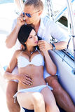 Young couple relacing on a boat Stock Photography