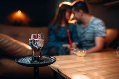 Young couple relax and smoking hookah Royalty Free Stock Photo