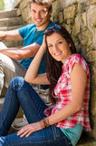 Young couple relax on stone stairs Stock Photo