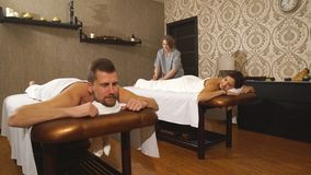 A young couple relaxes on couples massage in a Spa center stock video footage