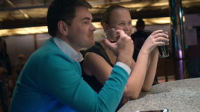 Young couple relaxing in bar and having drinks stock video footage