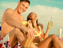 Young couple relaxing on a beach Royalty Free Stock Images