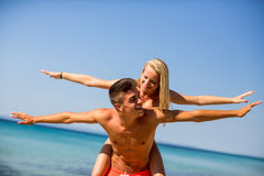 Young couple relaxing on the beach Royalty Free Stock Image
