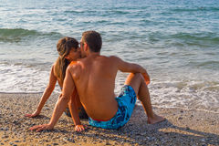 Young couple relaxing at the beach Royalty Free Stock Photo
