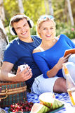 Young couple relaxing at the beach Stock Images
