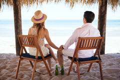 Young couple relaxing at the beach stock photography