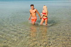 Young couple relaxing on the beach Stock Photos