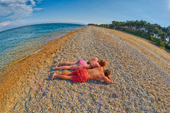 Young Couple Relaxing on a Beach Royalty Free Stock Image
