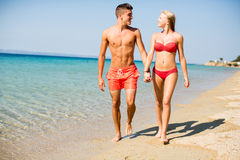 Young couple relaxing on the beach Stock Photography