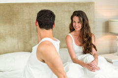 Young couple relaxing on bed Royalty Free Stock Photography