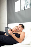 Young couple relaxing in bed Royalty Free Stock Photography