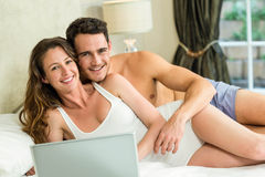 Young couple relaxing on bed Royalty Free Stock Images