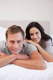 Young couple relaxing on the bed together Royalty Free Stock Images