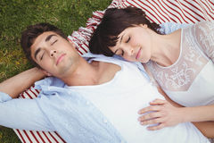 Young couple relaxing on blanket Stock Photos