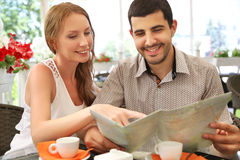 Young couple relaxing in a cafe Stock Photos