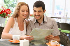 Young couple relaxing in a cafe Royalty Free Stock Photos