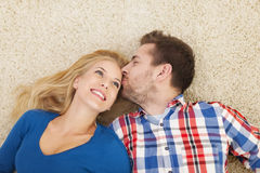 Young couple relaxing on carpet Royalty Free Stock Photography
