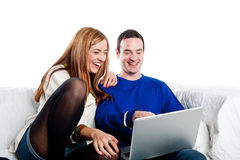 Young couple relaxing on the couch with laptop Royalty Free Stock Photo