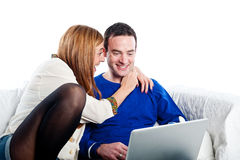 Young couple relaxing on the couch with laptop Stock Photo