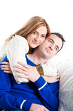 Young couple relaxing and cuddling together on the sofa Stock Image