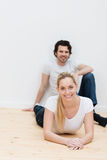 Young couple relaxing on the floor of a new home Stock Photography