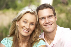 Young Couple Relaxing In Garden Royalty Free Stock Photo