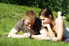 Young couple relaxing on the green Stock Photos