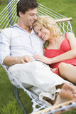 Young couple relaxing in hammock Royalty Free Stock Photo