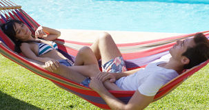 Young couple relaxing in a hammock Stock Photo