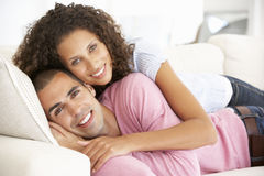 Young Couple Relaxing At Home Royalty Free Stock Photos