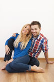 Young couple relaxing at home Stock Images