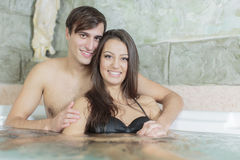 Young couple relaxing in the hot tub Stock Images