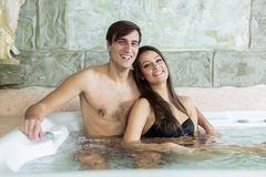 Young couple relaxing in hot tub Royalty Free Stock Images